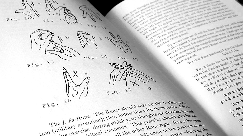 Rune=Magic page spread with mudras
