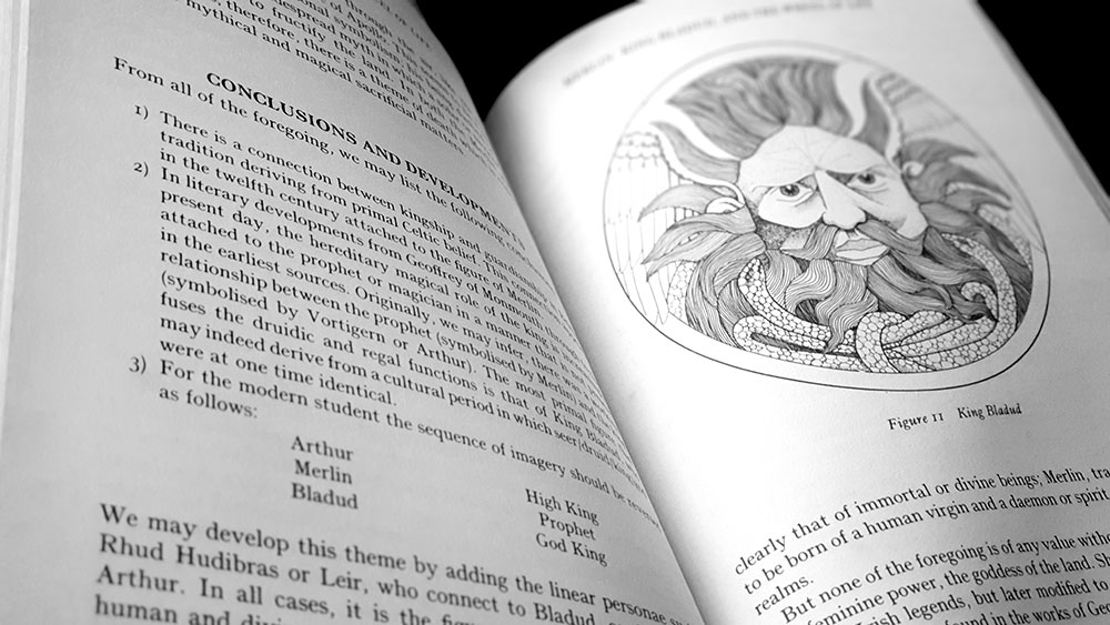 The Book of Merlin page spread with artwork by Miranda Gray